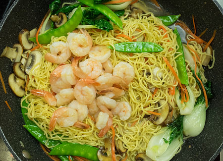 Add the noodles and the shrimp