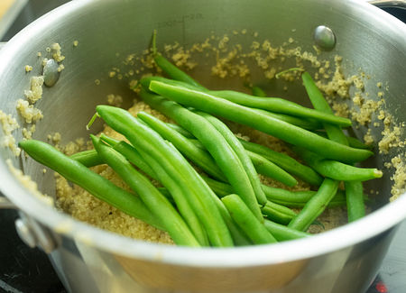 Add green beans to quinoa