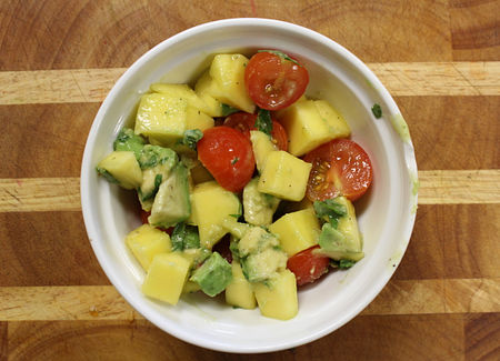 Chop up mint, peel and cut up mango and avocado